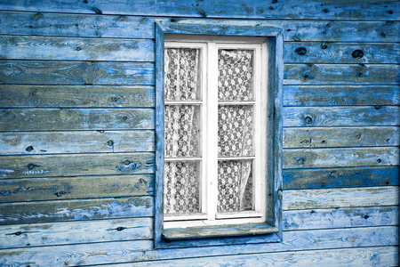 slovenly: Rural much neglected window in wooden wall of house, wooden background Stock Photo
