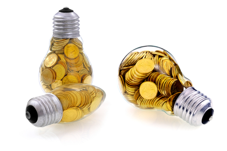 Traditional  lightbulb with  golden coins, creative business symbols photo