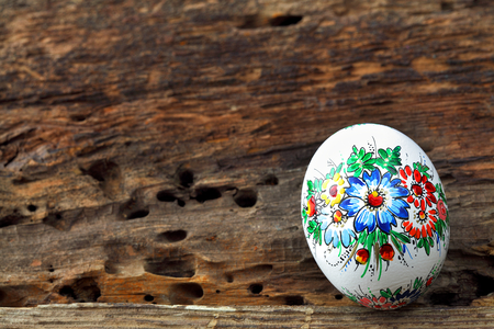 crack willow: Easter egg on old farmhouse rustic wooden table Stock Photo