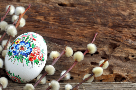 Easter egg on old farmhouse rustic wooden table photo