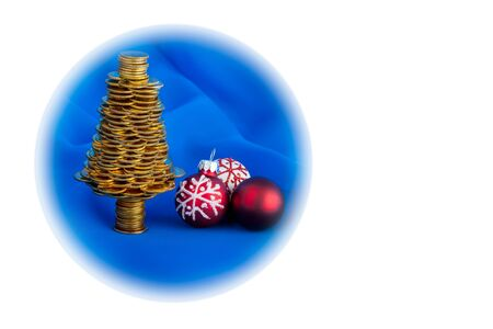 Golden happy Christmas tree with many golden coins on blue blur background, business metaphor