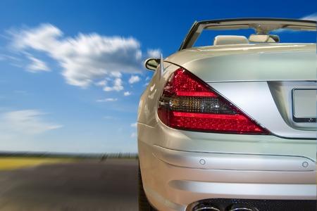 sportscar: Silver sportscar driving fast