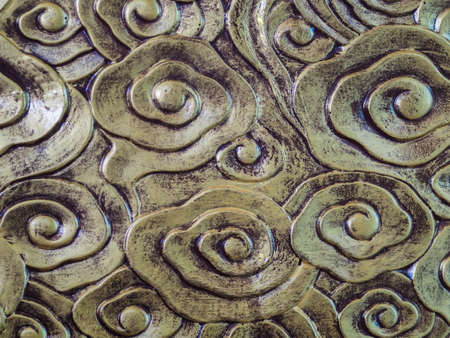 Close-up motifs on a sculpture in a Chinese temple, focusing on the spot.