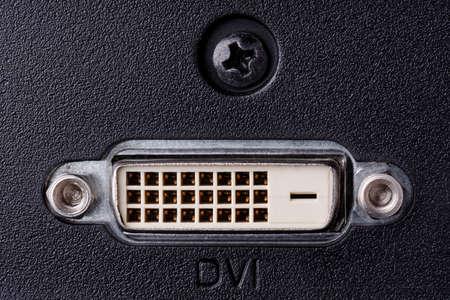 dvi: DVI connector on monitor black back panel.