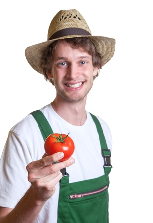 regional: Young farmer is happy with his fresh tomato