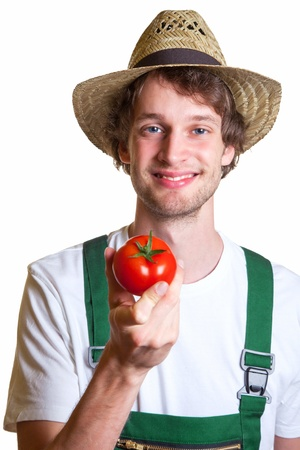 Young Farmer showing his fresh tomato Stock Photo - 20085525