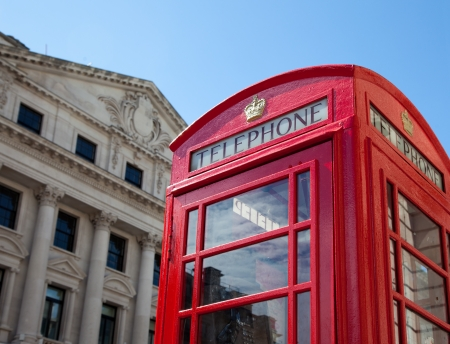 Phone booth in London with historic buildings photo