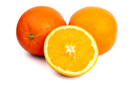 two and a half: Two oranges and one half in front Stock Photo