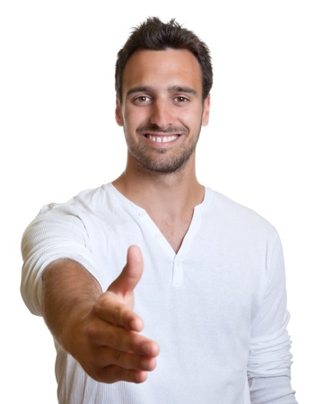 Young latin man giving hand photo