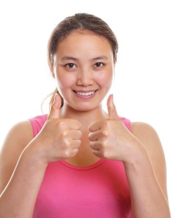 Asian girl showing both thumbs photo
