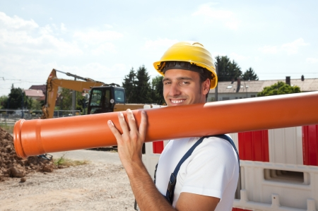 Smiling worker with a water pipe 免版税图像
