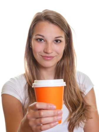 Young girl showing a cup of coffee   photo