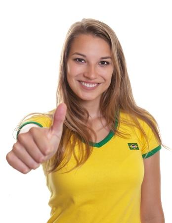 Glimlachend Braziliaans voetbal supporter zien bonzen Stockfoto