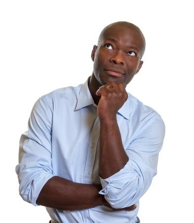 hombre pensando: Soñando empresario africano Foto de archivo