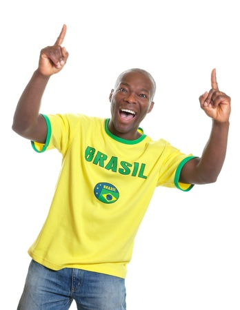 Brazilian soccer fan cheering and pointing  photo
