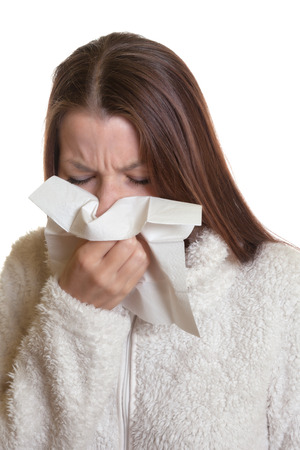 Sneezing woman has the flu photo