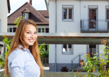 Young woman looking for a new house Stock Photo