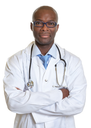 African doctor with crossed arms looking at camera 免版税图像