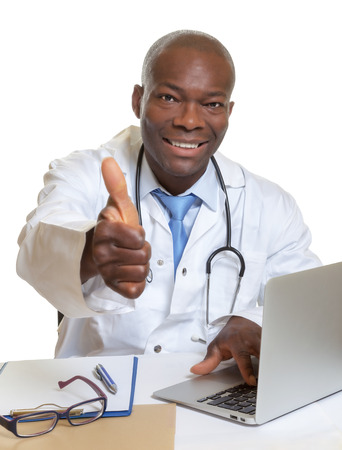 African doctor works at his computer photo