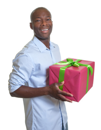 Handsome african guy with a christmas gift  photo