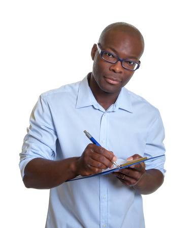 African businessman with clipboard   photo