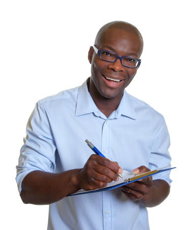 African business man writing notes on a clipboard   photo