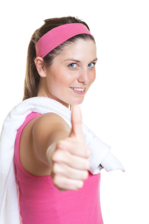 snazzy: Sporty woman in pink jersey showing thumb  Stock Photo