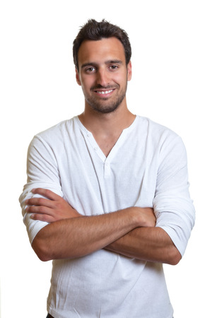 Standing latin man in a white shirt  photo