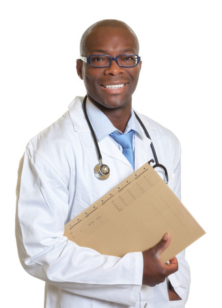 Laughing african doctor with a medical record in his hand  photo