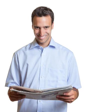 Latin man reading newspaper  photo
