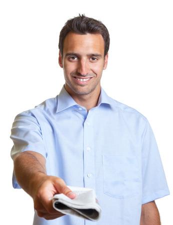 Latin man hands over a newspaper  photo
