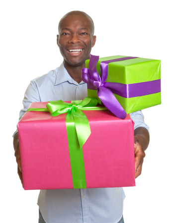 Laughing african man with two gifts for christmas  photo