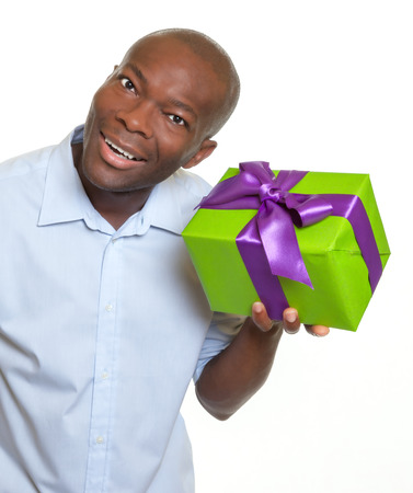 African man listening on a gift  photo