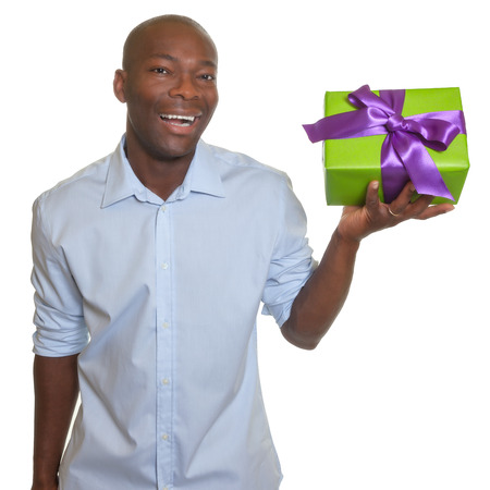 Laughing african man presents a gift  photo