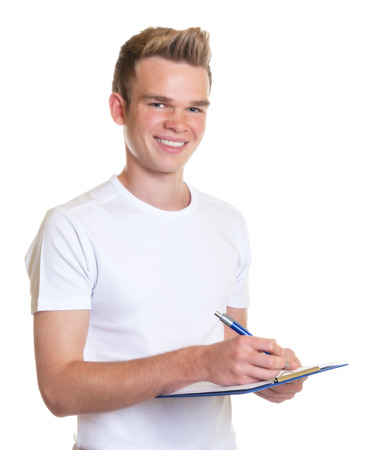 Young man making notes on a clipboard  photo