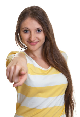 Woman with long brown hair pointing at camera photo