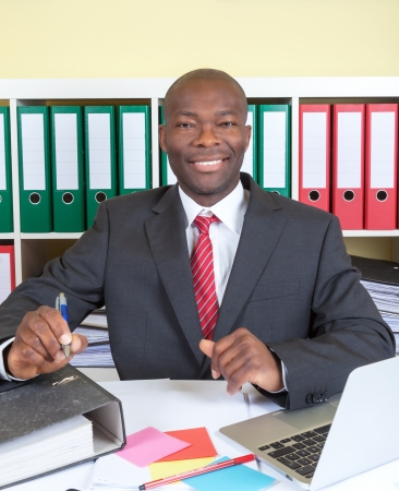 Laughing african businessman in his office photo