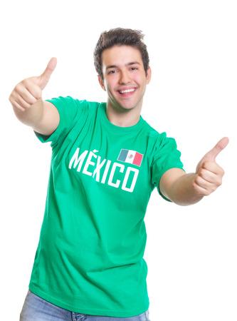 Lachen mexicaanse sportfan tonen beide duimen omhoog Stockfoto
