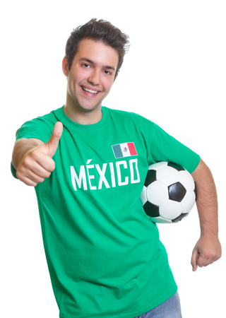 Laughing mexican soccer fan with ball showing thumb photo