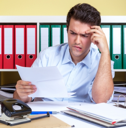 Hispanic guy with problems at office photo