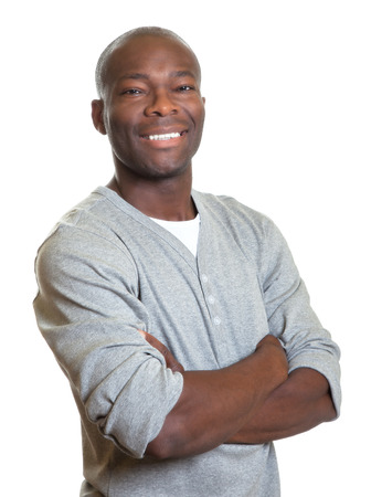 crossed arms: Attractive african man with crossed arms laughing at camera