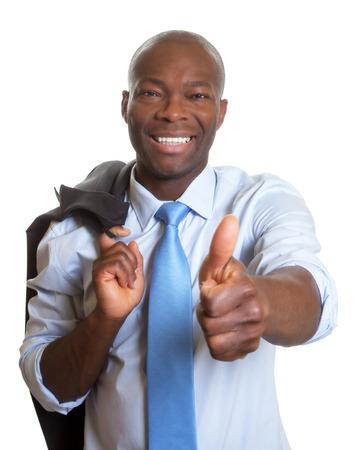 Afrikaanse zakenman met jas duim toont Stockfoto