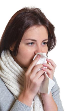 sniffles: Sneezing woman with dark hair has the flu