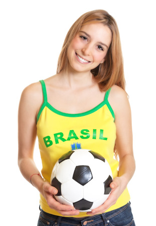 Laughing brazilian sports fan with ball photo