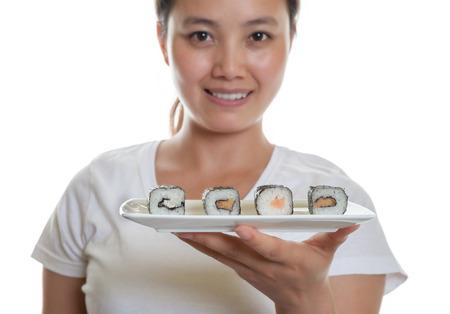 Fresh sushi rolls with japanese waitress photo