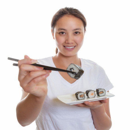 Japanese woman tasting fresh sushi rolls photo