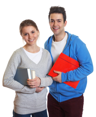 Two students with books and paperwork looking at camera Stock Photo - 24834805