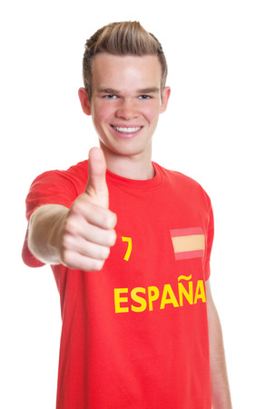 Spanish sports fan with blond hair showing thumb up Stock Photo