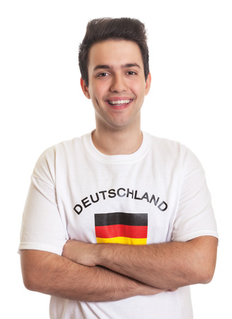 Laughing german sports fan with crossed arms and black hair photo