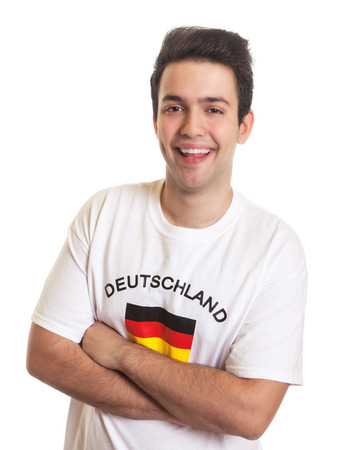 German sports fan with black hair laughing at camera